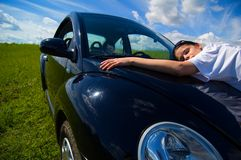 I Love This Car. A woman expresses her love for her car by hugging it Stock Photography