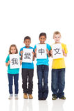 I love chinese. Cute group kids holding paper saying i love chinese, written in chinese stock image