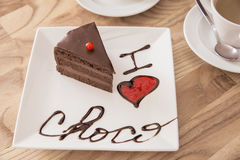 I love choco. Brownie cake with coffee and words I love choco written with chocolate, focus on words Royalty Free Stock Photography