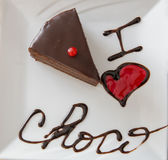 I love choco. Brownie cake and words I love choco written with chocolate, focus on words Royalty Free Stock Photo
