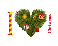 I love Christmas. Symbol of heart of FIR branches. Gift with Red. Ribbon and Christmas toys. Conifer twig wreath in shape of heart Royalty Free Stock Photo