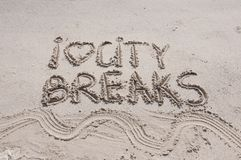 I Love City Breaks message written on sand, vacation concept, color filter applied Royalty Free Stock Photo