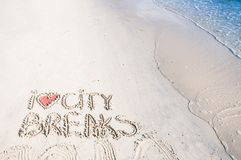 I Love City Breaks message written on sand, vacation concept, color filter applied Stock Photo