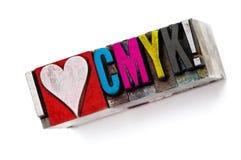 I love CMYK. The phrase I love CMYK in letterpress type, narrow focus macro stock images