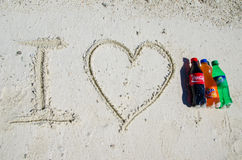 I love coca-cola, fanta, sprite bottles on sand Stock Photos