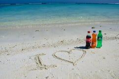 I love coca-cola, fanta, sprite bottles on sand Royalty Free Stock Photo