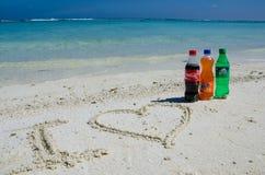I love coca-cola, fanta, sprite bottles on sand Stock Photo