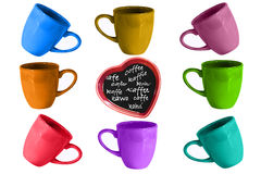 I love Coffee. Assorted coffe cups in bright colors with a heart in the center with coffee and the word coffee in various languages Royalty Free Stock Photography