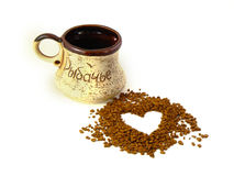 I love coffee. Instant coffee in the form of heart, a cup beside Royalty Free Stock Images