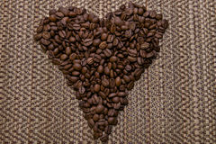 I love coffee. Coffee beans in the shape of a heart on a bamboo background Royalty Free Stock Photo