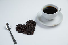 I love coffee concept. Love shape coffee bean with cup coffee on the white background Stock Photo