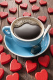 Love Coffee Cup. A cup of black coffee surrounded by red love hearts Stock Images