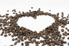 A heart of roasted coffee beans stock image