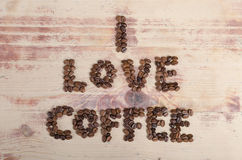 I love coffee. Inscription I love coffee from beans on wood Royalty Free Stock Photo