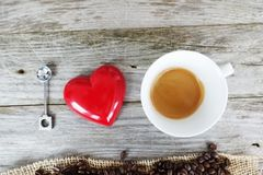 I love coffee quote with natural coffee beans in heart shape on a wooden kitchen table royalty free stock photography