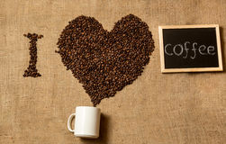 I love coffee written by coffee beans and chalkboard. Closeup photo of I love coffee written by coffee beans and chalkboard Stock Photo