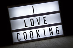 I love cooking. `I love cooking` text in lightbox royalty free stock photo