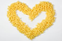 I love corn. Heart of corn sticks on white background Royalty Free Stock Image