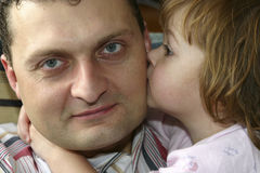 I love dad. Little girl cuddling her daddy Stock Photo