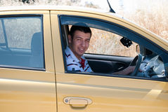 I love driving. A young man smiling from his car Royalty Free Stock Photos