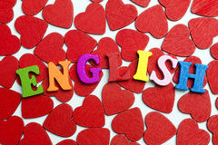 I love the English. Word in little hearts lying on the floor Royalty Free Stock Photography