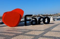 Faro Harbour With Signage. I love Faro Portugal signage and boats at Faro Harbour at Rio Formosa royalty free stock photography