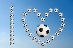 I love football. Soccer balls forming phrase, I love football with blue sky background Stock Photos
