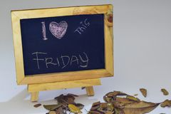 Free I Love Friday Written On A Chalkboard. Autumn Seasonal Flat Lay Photo On White Background Stock Images - 122823044