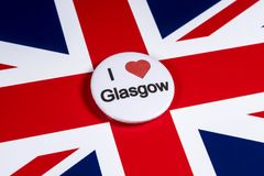 I Love Glasgow. LONDON, UK - APRIL 27TH 2018: An I Love Glasgow badge pictured over the UK flag, on 27th April 2018 Stock Photos