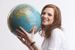 I love the globe. One young woman with a white shirt is holding a globe Royalty Free Stock Images
