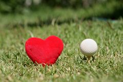 I love golf. Golf ball and heart Stock Images