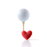 I Love Golf. Studio image of white golf ball on a wooden tee with a red heart shape. Concept image for I Love Golf or Father's Day. Copy space stock photography