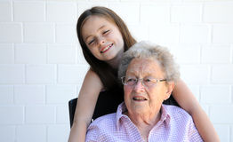 I love grandma. Young and old, granddaughter with their ninety years old grandmother Royalty Free Stock Photo