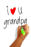 I love grandpa. Girls hand holding a pen writing i love grandpa greeting card Royalty Free Stock Photos