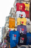`I love HK` t-shirts hanging at a souvenir stall at the Ladies Market in the Mong Kok area of Kowloon, Hong Kong Stock Photography