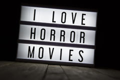 I love horror movies. `I love horror movies` text in lightbox Royalty Free Stock Image