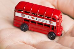 I love London message on red bus, souvenir and symbol of London City, isolated on woman's hand royalty free stock photos