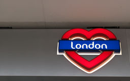 I Love London - Neon sign: London written on a blue  background. In a red heart Stock Photo