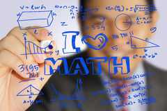 I Love Math. Educational concept image of a happy teacher holding marker and write I Love Math with mathematics formulas doodle Stock Image