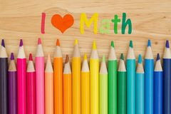 I love math message with pencil crayons. I love math text with colorful pencil crayons on a desk royalty free stock photos