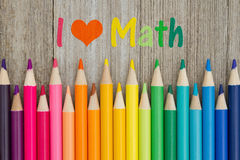 I love math message with pencil crayons. I love math text with colorful pencil crayons on a weathered wood royalty free stock images