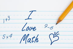 I love math message. I love math text on retro lined paper with a pencil stock image
