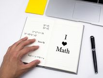 I love math on note book on desk.  Stock Photos