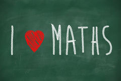I love maths. Phrase handwritten on the school blackboard Royalty Free Stock Photo