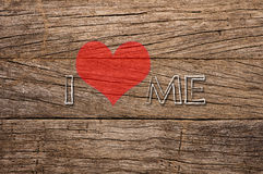 I love me written on wooden background Stock Photography