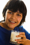 I love milk. Smiling boy with a glass of milk Stock Images