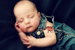 I love Mom. Baby boy with Mom Tattoo and Overall's stock photo