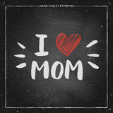 I love mom - quote with red heart. Happy Mothers Day Card - hand drawn chalk letter on chalkboard, I love mom - quote with red heart, design for greeting card Royalty Free Stock Photos