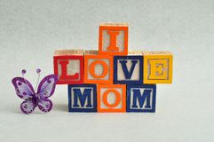 I love mom spelled with colorful alphabet blocks Stock Image