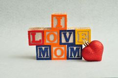 I love mom spelled with colorful alphabet blocks Royalty Free Stock Images